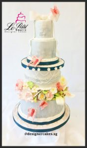 4 Tier - Silver Fondant Cake with Sugar Flowers, Ribbon and Sugar Butterflies.