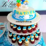 Customized Baby Shower Rocking Horse Cake & Cup Cake Tower with Baby Boy Blue and White Themed Mini Cup Cakes.