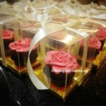Flower Cup Cakes - Piped Butter Cream Roses in individual Gold Boxes and Ribbons.