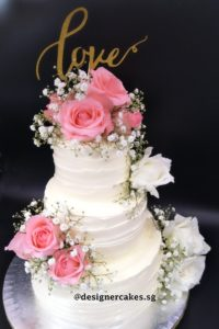 Fresh Flower Cakes - 3 Tier Cream Cake with Roses and Baby Breath.