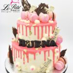 Drip Cake - 2 Tier pink and white drip cake with chocolates, macarons and edible gold leaf. Singapore Customized Cakes