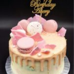 Drip Cake - Marbled pastel pink and blue drip cake with macarons and chocolate shards. Singapore Customized Cakes